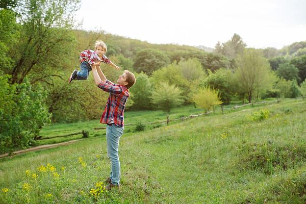 child playing with dad